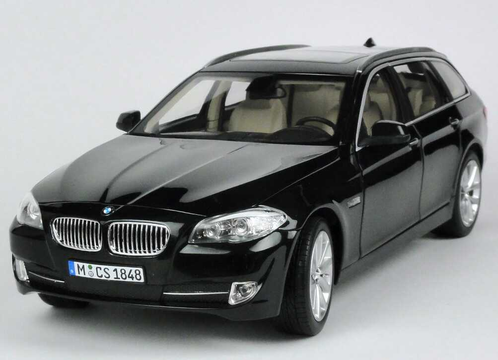 bmw 5er 550i touring f11 saphirschwarz met werbemodell. Black Bedroom Furniture Sets. Home Design Ideas