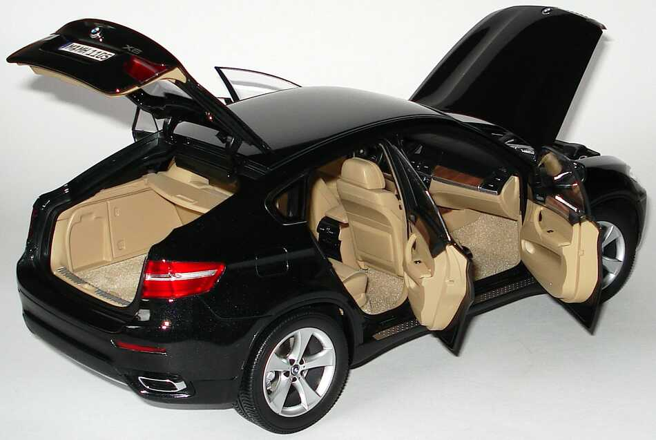 bmw x6 xdrive 50i saphirschwarz met werbemodell kyosho 80430428195 bild 9. Black Bedroom Furniture Sets. Home Design Ideas