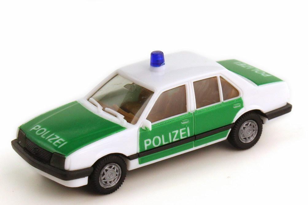 1:87 Opel Ascona C Stufenheck Polizei grün/weiß, Räder 2teilig, IA braun (oV)