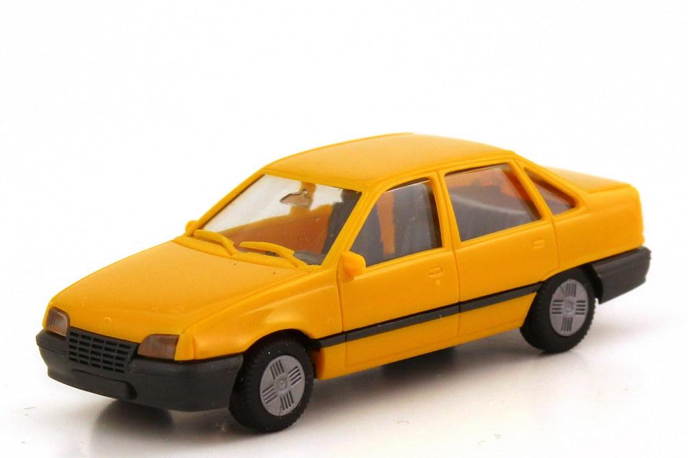 Foto 1:87 Opel Kadett E Stufenheck gelb - herpa 2055
