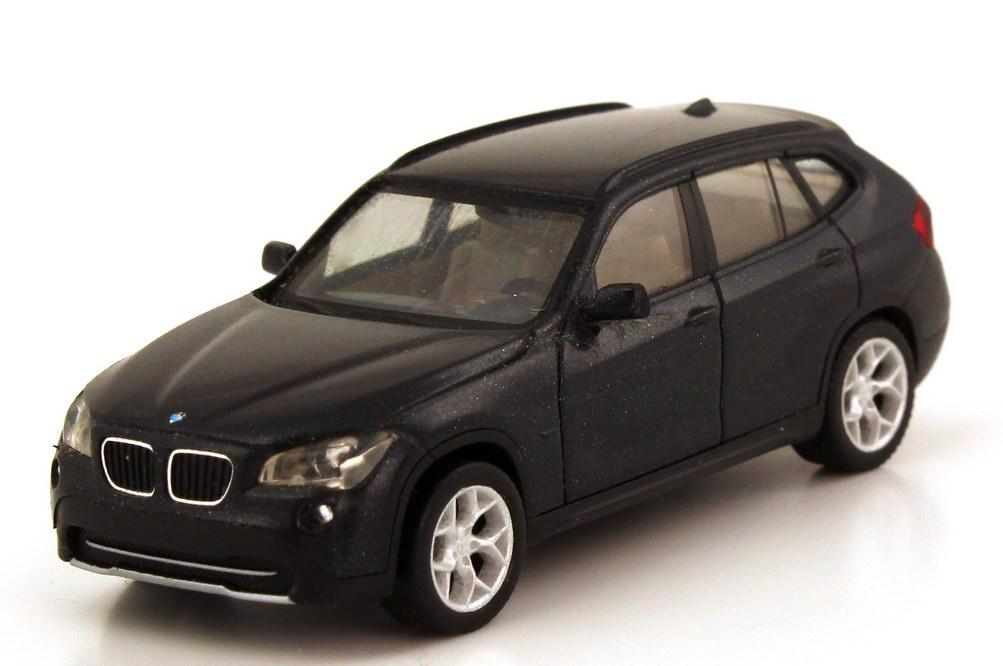 Foto 1:87 BMW X1 (E84) saphirschwarz-met. herpa 80412156808