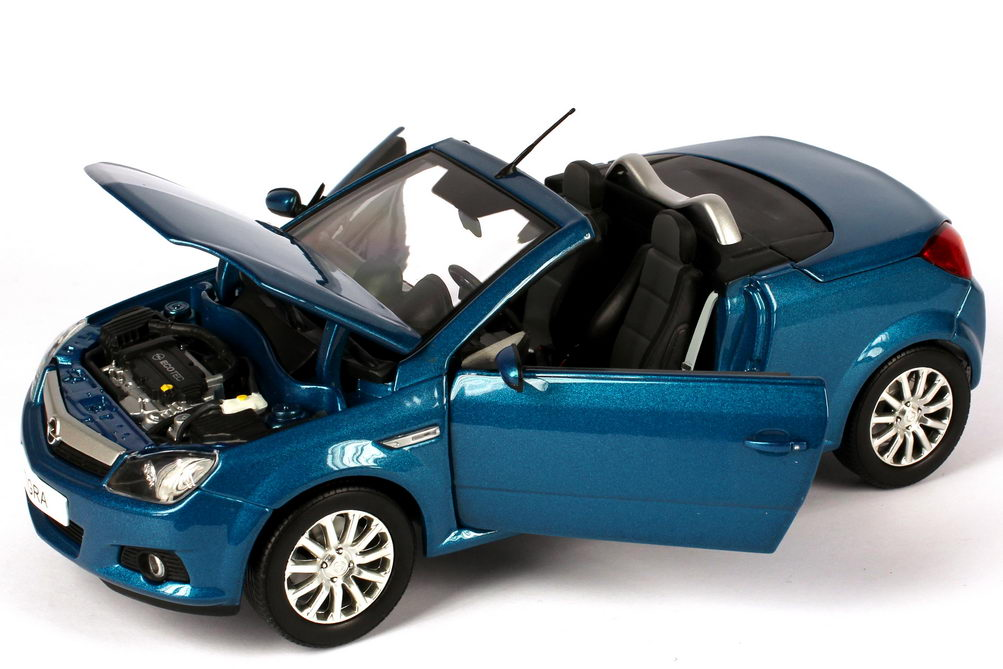 Foto 1:18 Opel Tigra TwinTop antigua-blau-met. mit funktionalem Verdeck Werbemodell Norev