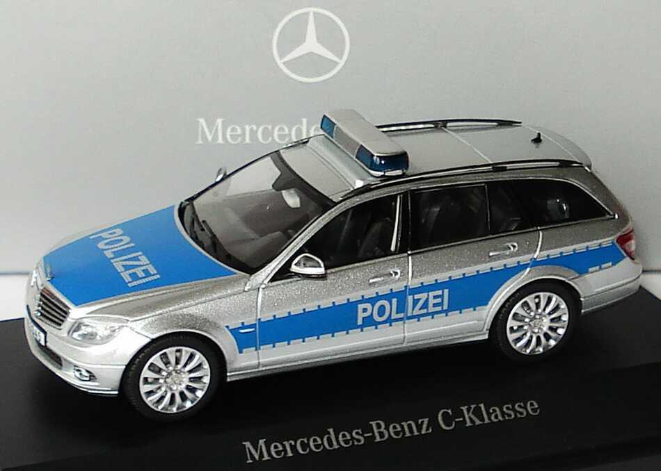 Foto 1:43 Mercedes-Benz C-Klasse T-Modell Elegance (S204) Polizei iridiumsilbermet./blau Werbemodell Schuco B66960329