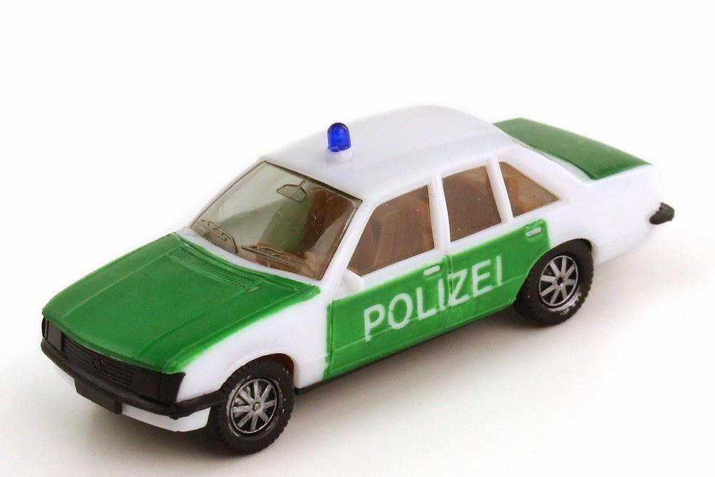Foto 1:87 Opel Rekord E Polizei weiß grün Schrift groß - herpa 4040