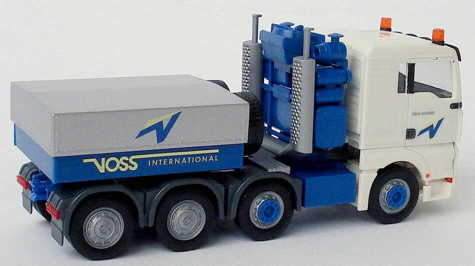 Foto 1:87 MAN TG-A XL 4a Schwerlastzugmaschine Voss International (Intermodellbau 2004) herpa 269308