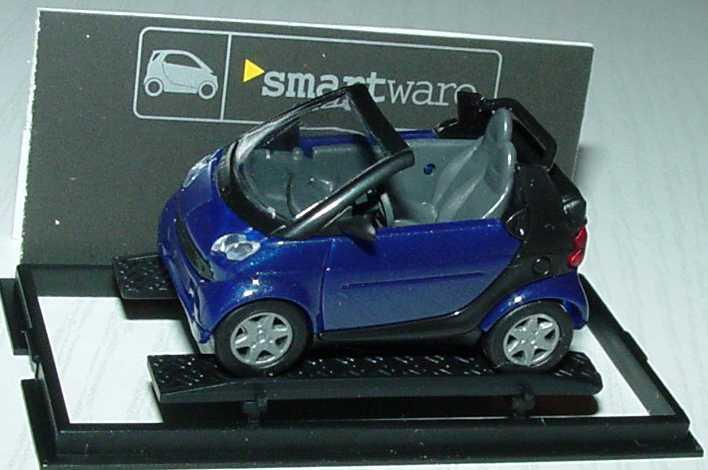 Foto 1:87 MCC Smart Cabrio dunkelblau/schwarz Werbemodell Busch 0013097V001000000