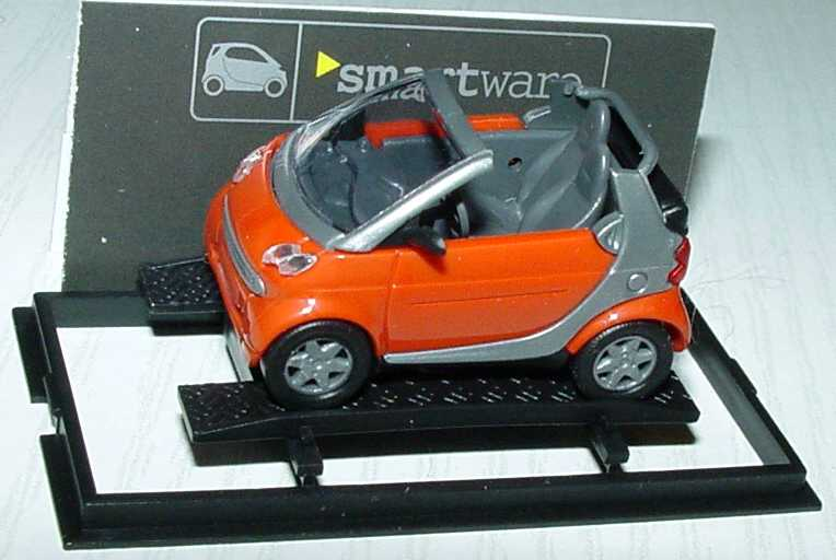 Foto 1:87 MCC Smart Cabrio dunkelorange/silber Werbemodell Busch 0013097V001000000