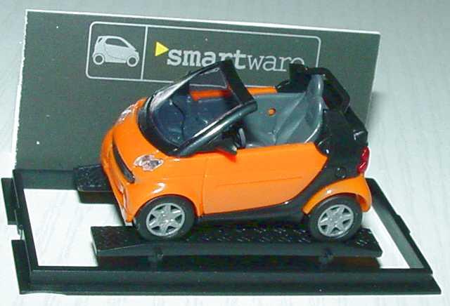 Foto 1:87 MCC Smart Cabrio orange/schwarz Werbemodell Busch 0013097V001000000