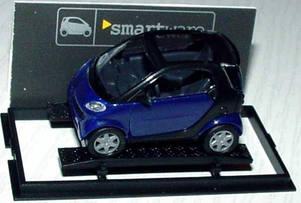Foto 1:87 MCC Smart City-Coupé dunkelblau/schwarz Werbemodell Busch 0013097V001000000