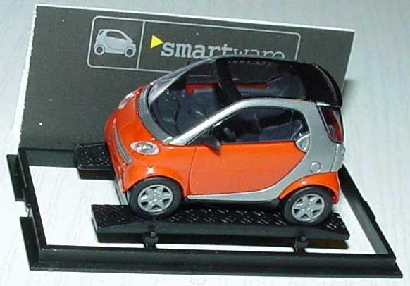 Foto 1:87 MCC Smart City-Coupé dunkelorange/silber Werbemodell Busch 0013097V001000000