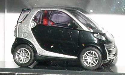 Foto 1:87 MCC Smart City-Coupé jack-black/silber-met. Werbemodell Kartonverpackung Busch 0012444V001C51Q00