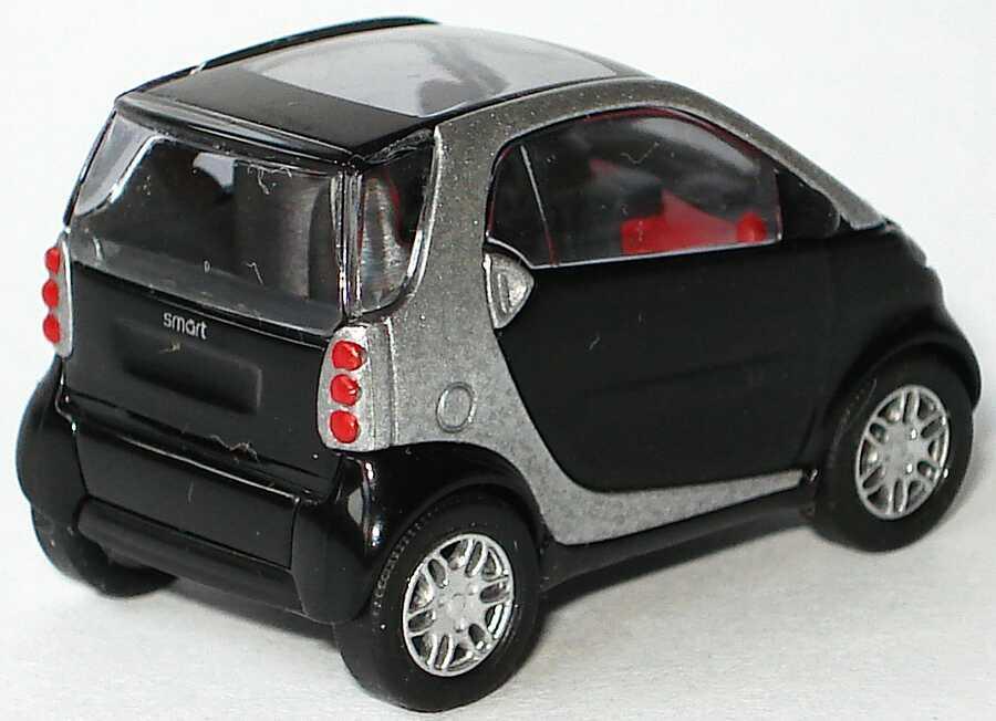 Foto 1:87 MCC Smart City-Coupé jack-black/silbermet., rote Sitze Busch