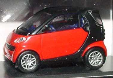 Foto 1:87 MCC Smart City-Coupé mad-red/schwarz + Bodypanels in hello-yellow Werbemodell Busch 0004832V000C07Q00