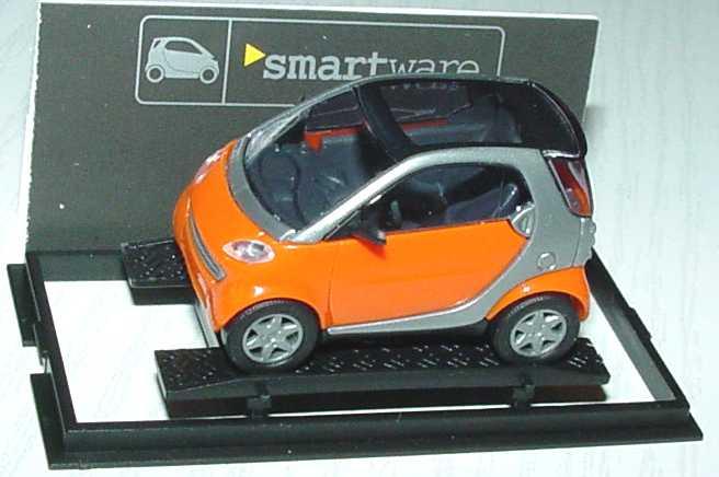 Foto 1:87 MCC Smart City-Coupé orange/silber Werbemodell Busch 0013097V001000000