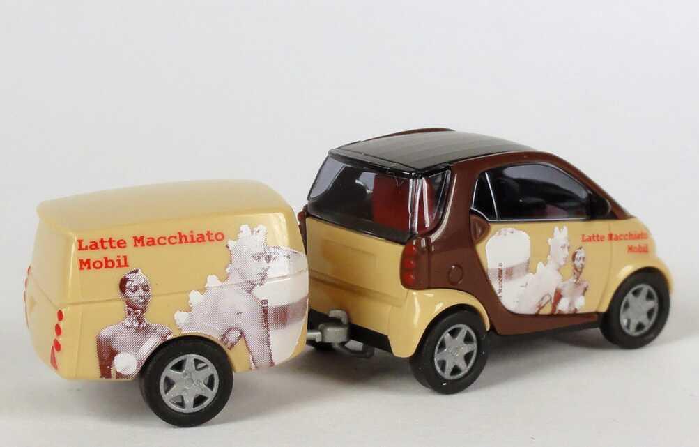 Foto 1:87 MCC Smart Fortwo mit Clevertrailer Latte Macchiato Mobil Busch 48946