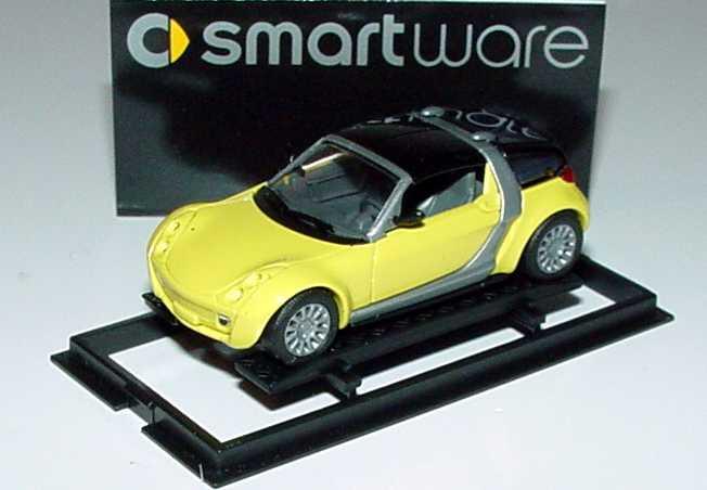 Foto 1:87 MCC Smart Roadster Coupé shine-yellow, Scheinwerfereinfassung in Wagenfarbe Werbemodell Busch 0013097V002000000