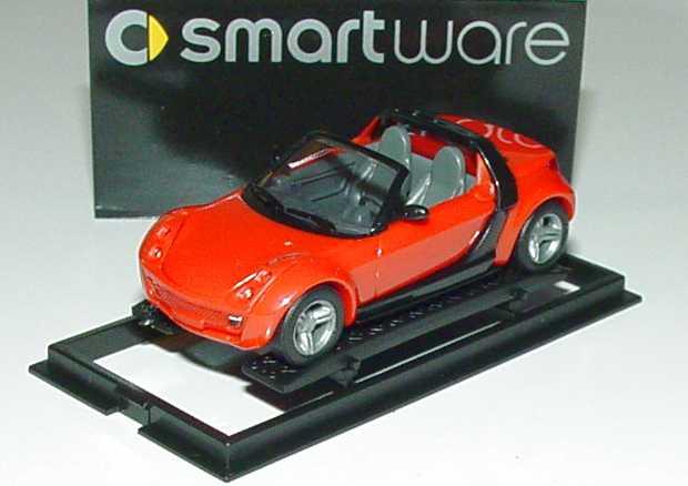 Foto 1:87 MCC Smart Roadster mad-red, Scheinwerfereinfassung in Wagenfarbe Werbemodell Busch 0013097V002000000