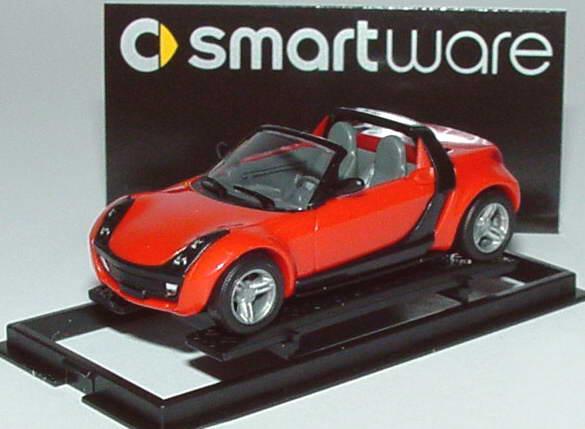 Foto 1:87 MCC Smart Roadster mad-red, Scheinwerfereinfassung schwarz Werbemodell Busch 0013097V003000000