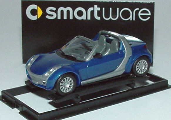 Foto 1:87 MCC Smart Roadster star-blue-met., Scheinwerfereinfassung silbergrau Werbemodell Busch 0013097V003000000