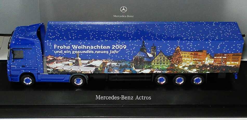 Foto 1:87 Mercedes-Benz Actros Megaspace MP3 KoSzg 2/3 Frohe Weihnachten 2009, Stuttgarter Weihnachtsmarkt Werbemodell herpa B66007803