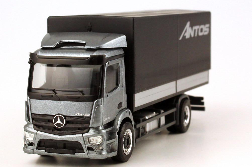 Foto 1:87 Mercedes-Benz Antos Pritsche/Plane andorit-grau-met. Werbemodell - herpa B66004090