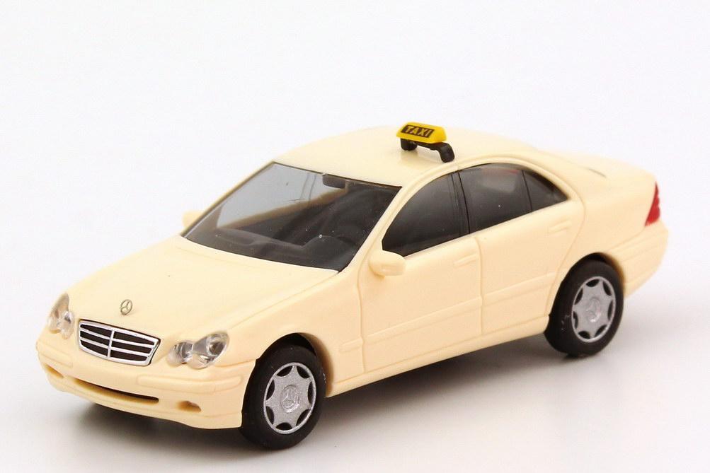 Foto 1:87 Mercedes-Benz C-Klasse (W203) Taxi hellelfenbein Busch 49104