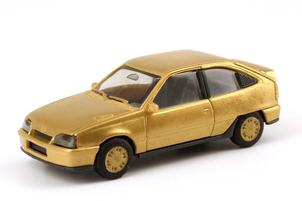 Foto 1:87 Opel Kadett E GSi gold-met., Felgen gold herpa 3046-AusPackung166096/1985