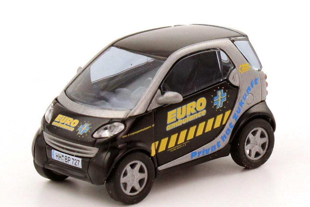 Foto 1:87 Smart City-Coupé Euro Ambulance - Privat hat Zukunft Busch 48931
