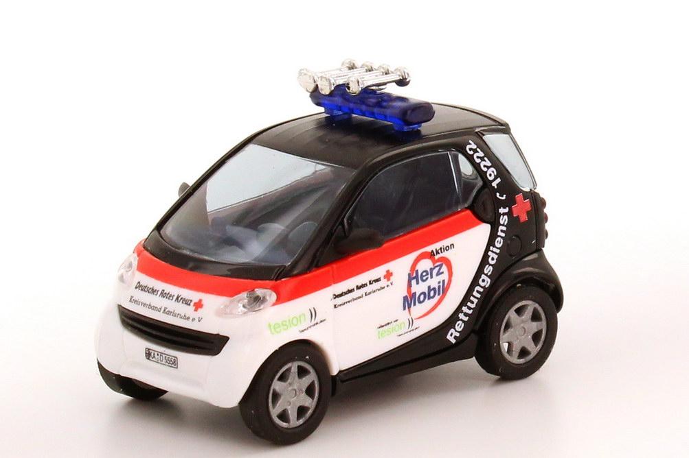 Foto 1:87 Smart City-Coupé Herz Mobil DRK Karlsruhe Busch 48924