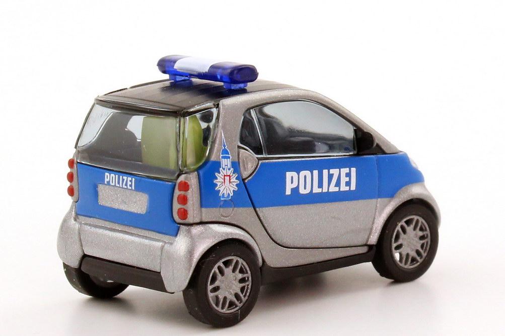 Foto 1:87 Smart City-Coupé Polizei Hamburg silber-met./blau Busch 48929