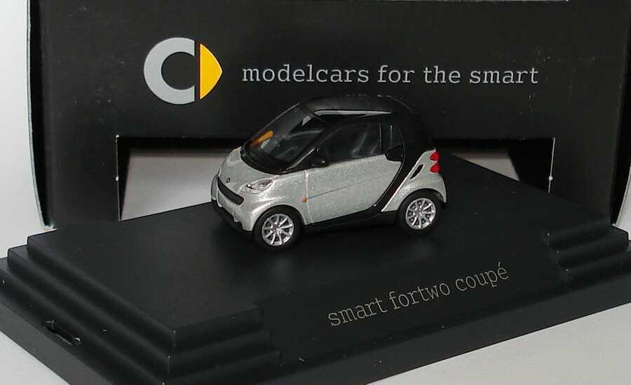 Foto 1:87 Smart Fortwo II Coupé C451 silber-met. - Werbemodell - Busch Q0022530V001C75Q00