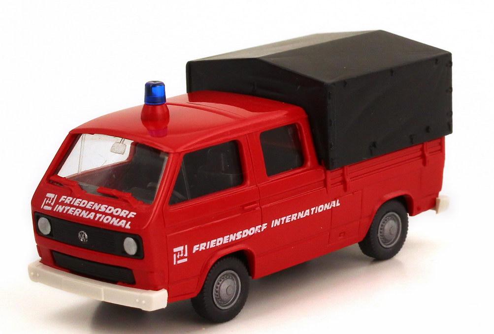 Foto 1:87 VW T3 Doka Pritsche/Plane Feuerwehr rot Friedensdorf International Roco 9302