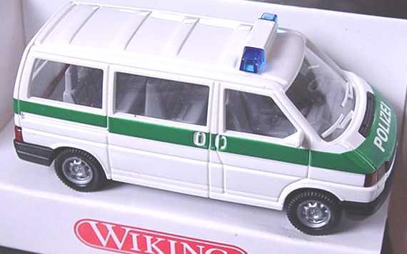 Foto 1:87 VW T4 Caravelle Polizei weiß/grün Wiking 1090123